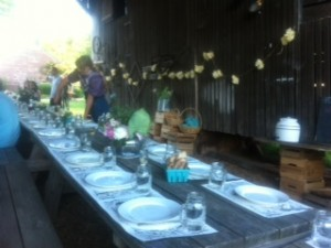 A long table set up in the corn crib for a beautiful meal served family style